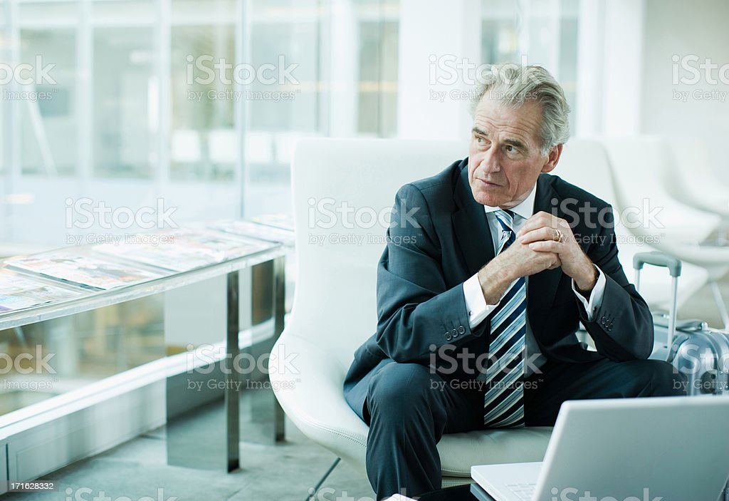 Businessman using laptop while traveling stock photo