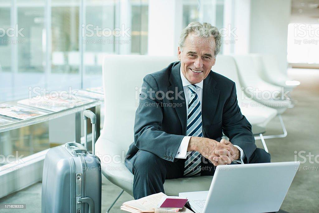 Businessman using laptop while traveling stock photo