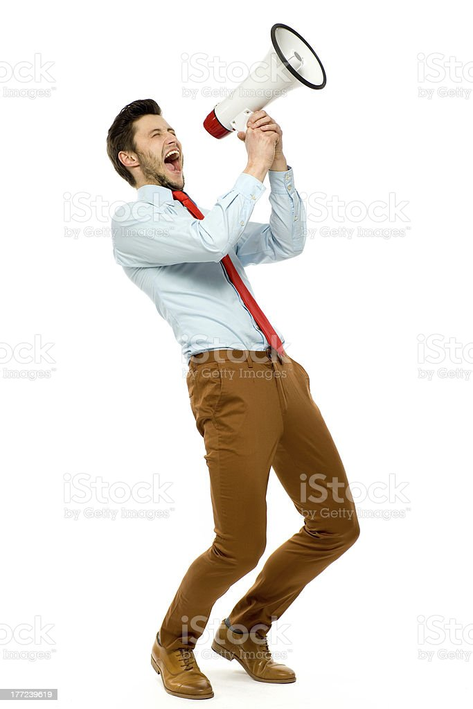 Businessman using megaphone stock photo