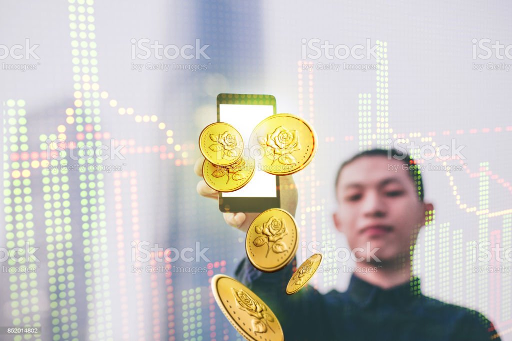 Businessman using mobile phone in stock market stock photo