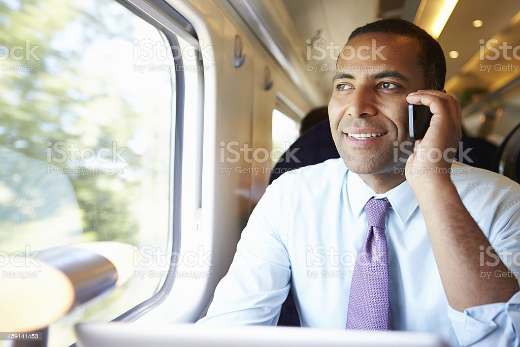 Businessman Using Mobile Phone on Train stock photo