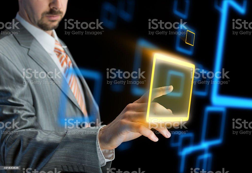 Businessman using modern virtual interface stock photo