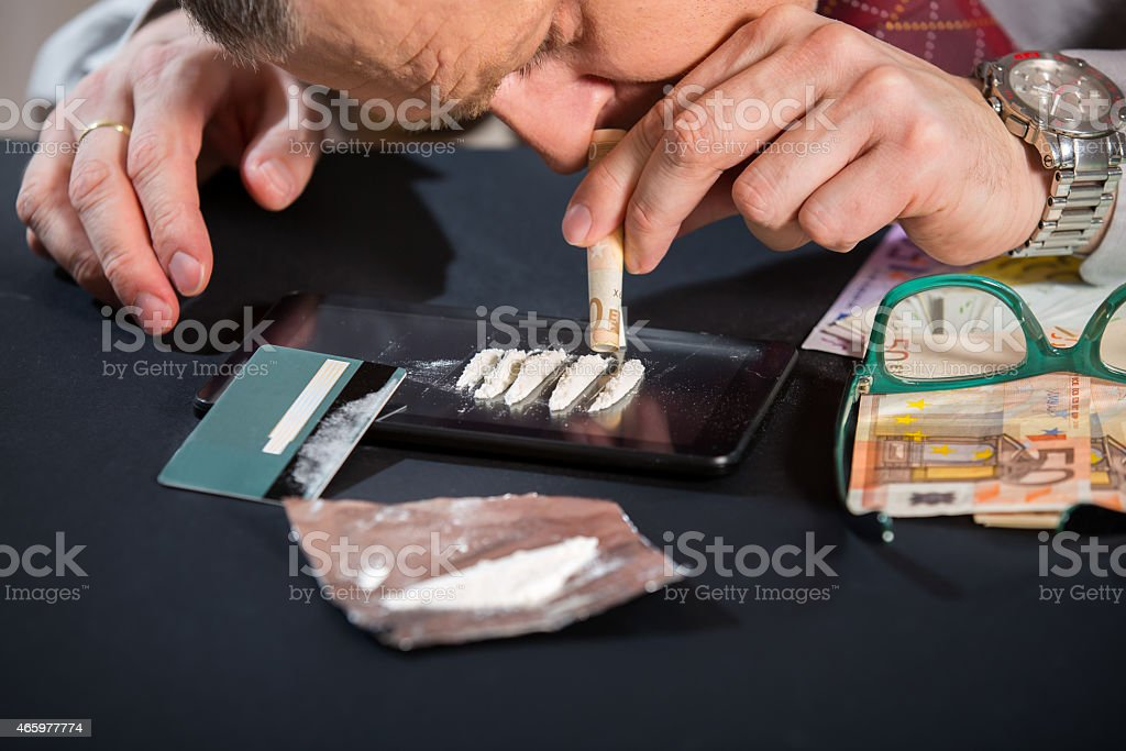 Businessman Using Narcotics stock photo