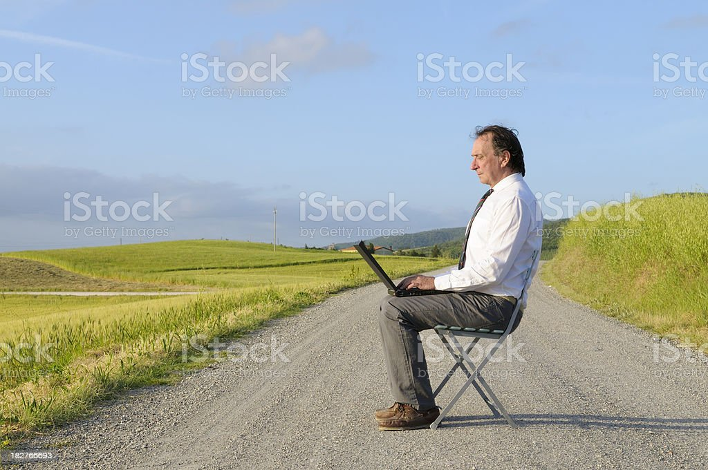 Businessman Using PC in the Countryside royalty-free stock photo