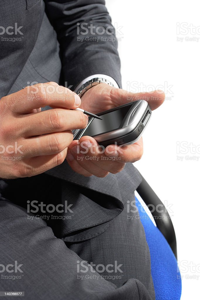 businessman using pda royalty-free stock photo