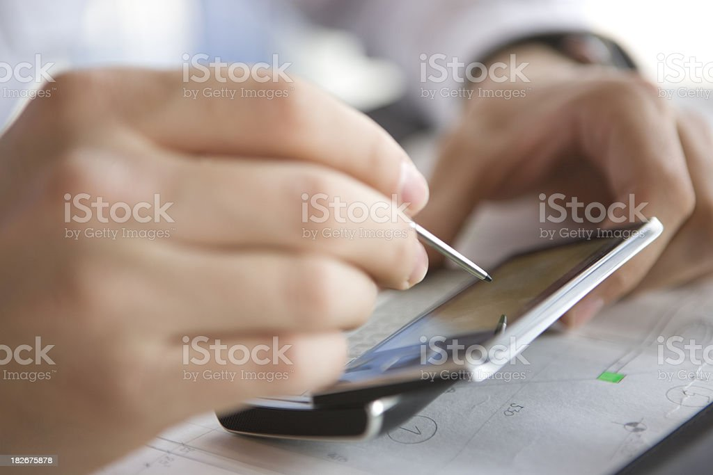 Businessman using PDA royalty-free stock photo