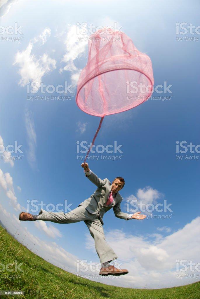 Businessman Using Pink Butterfly Net, Fisheye royalty-free stock photo