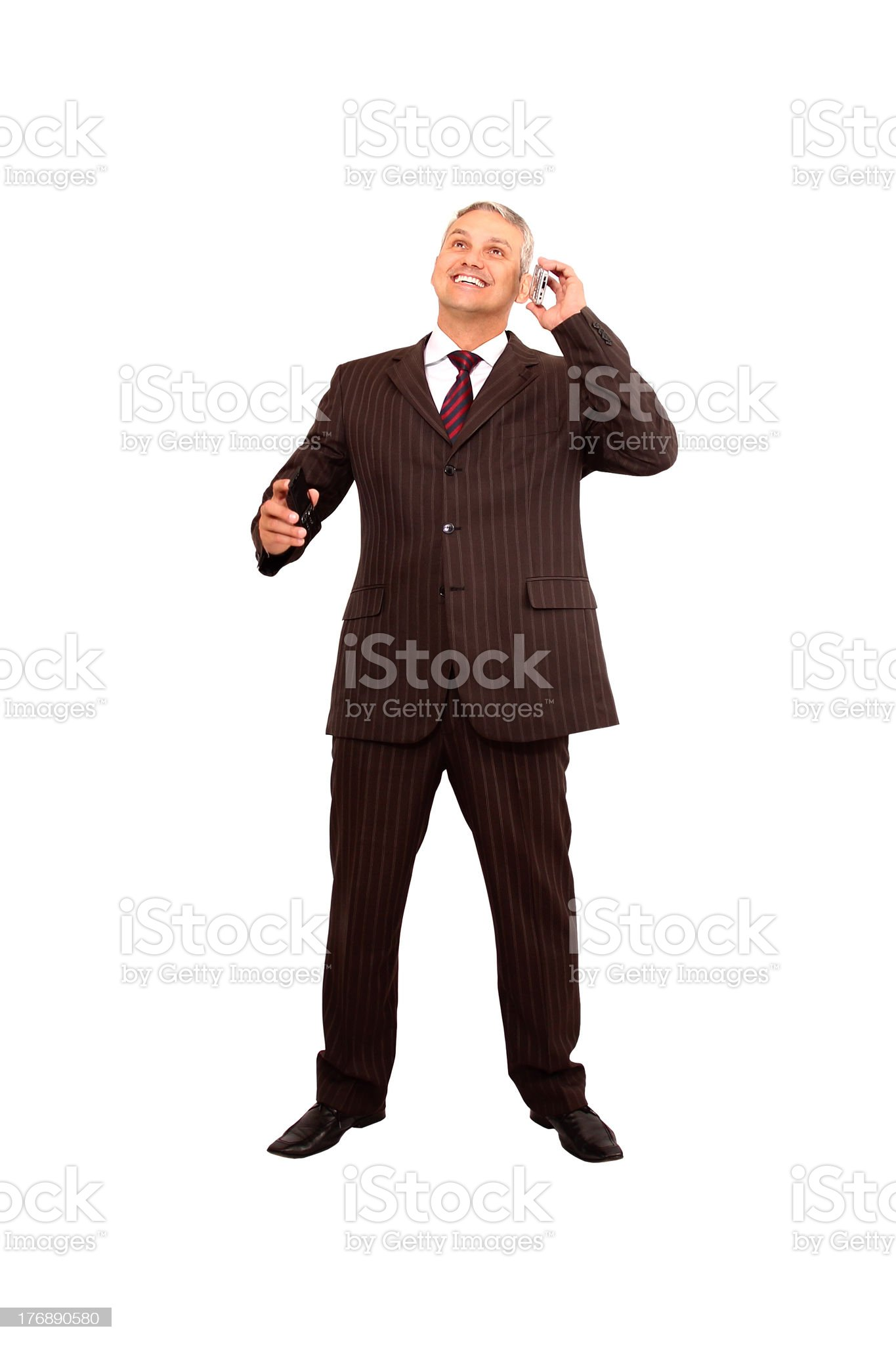 Businessman using smart phone and cellular royalty-free stock photo
