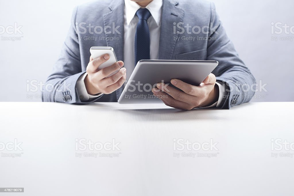 Businessman Using Smart Phone and Tablet royalty-free stock photo