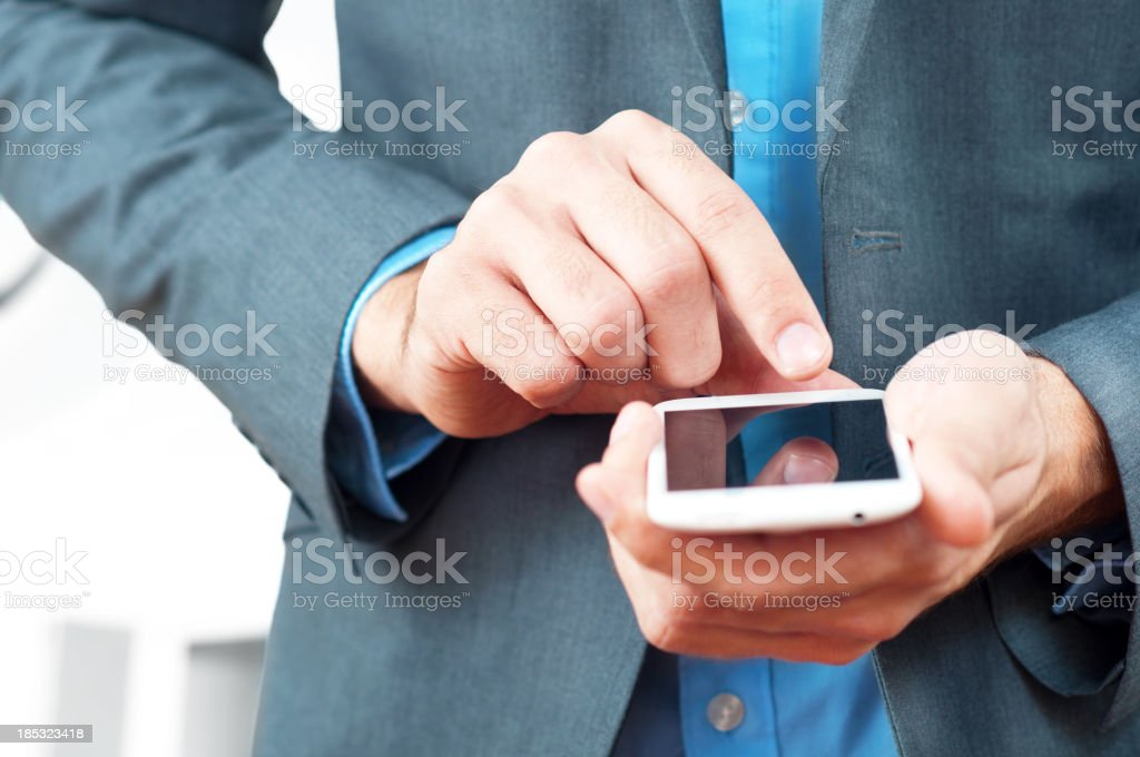 businessman using smart phone royalty-free stock photo