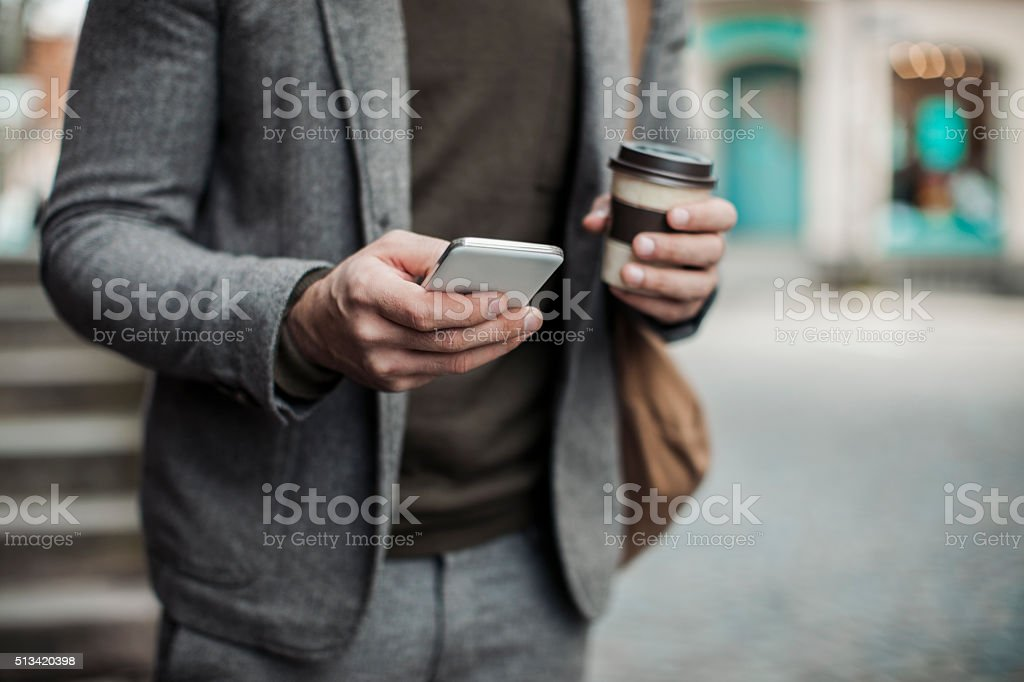 Businessman using smart phone stock photo