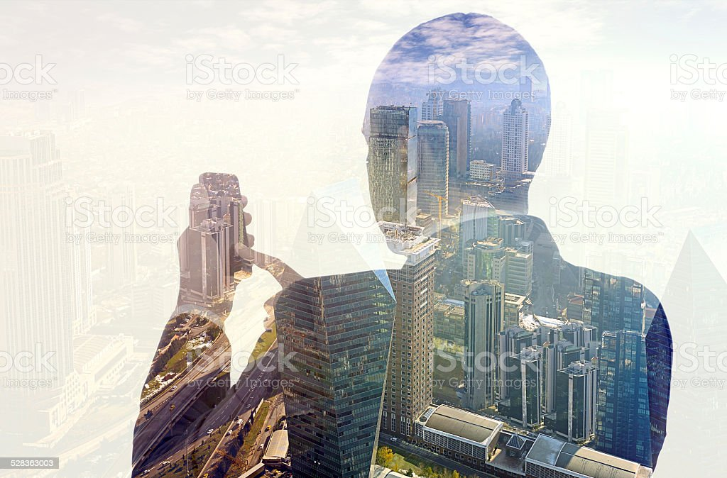 Businessman using smartphone double exposure stock photo