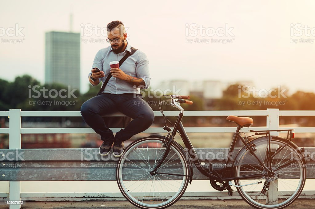 Businessman Using Smartphone Outdoors. stock photo