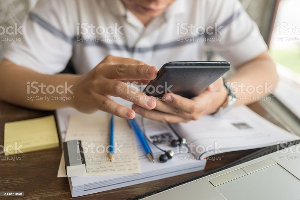 Businessman using smartphone to search information on the Internet stock photo