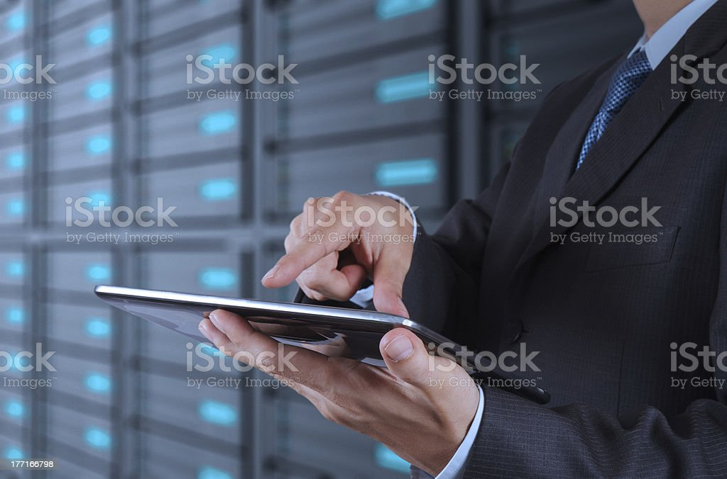 businessman  using tablet computer and server room background royalty-free stock photo