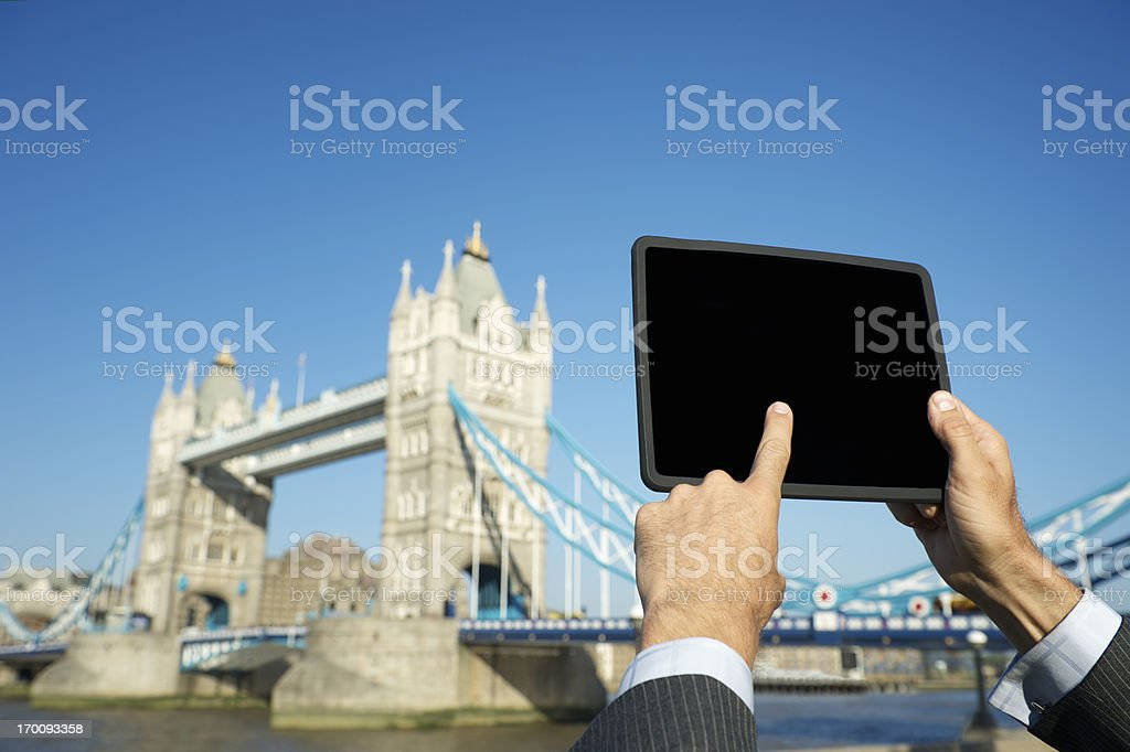 Businessman Using Tablet Computer London Skyline royalty-free stock photo