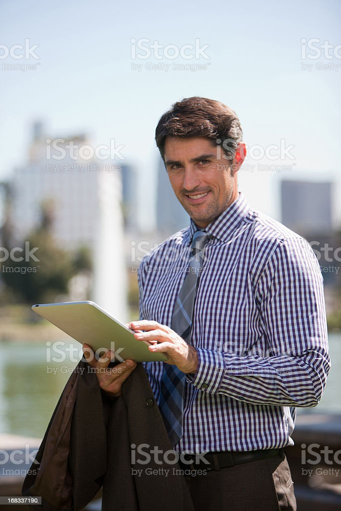 Businessman using tablet computer outdoors royalty-free stock photo