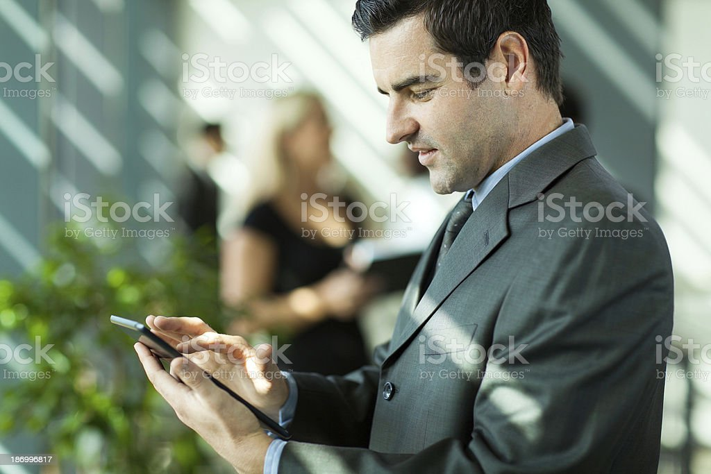 businessman using tablet computer royalty-free stock photo