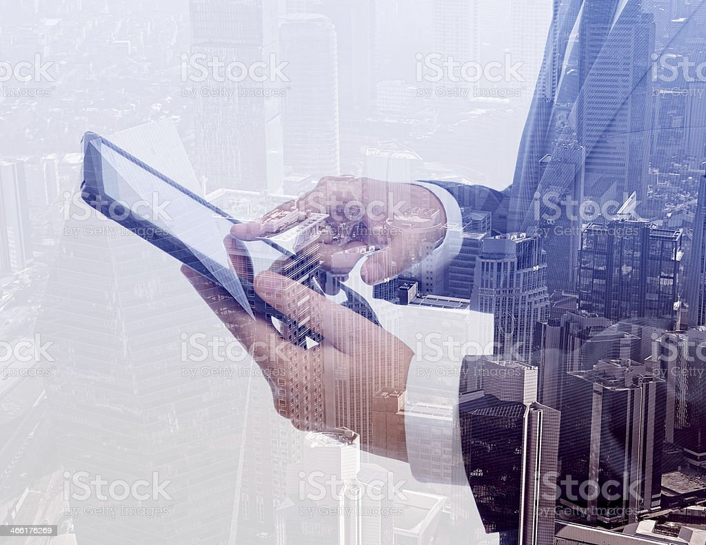 Businessman using tablet pc & double exposure stock photo