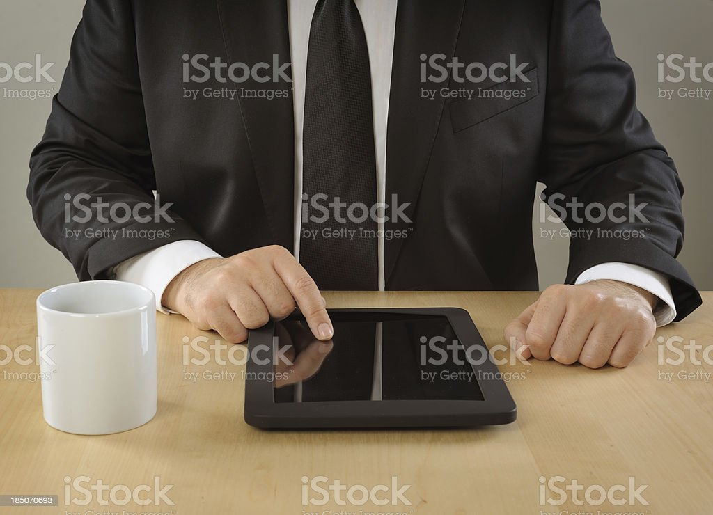 Businessman using tablet pc royalty-free stock photo