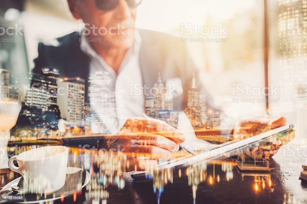 Businessman using tablet pc stock photo