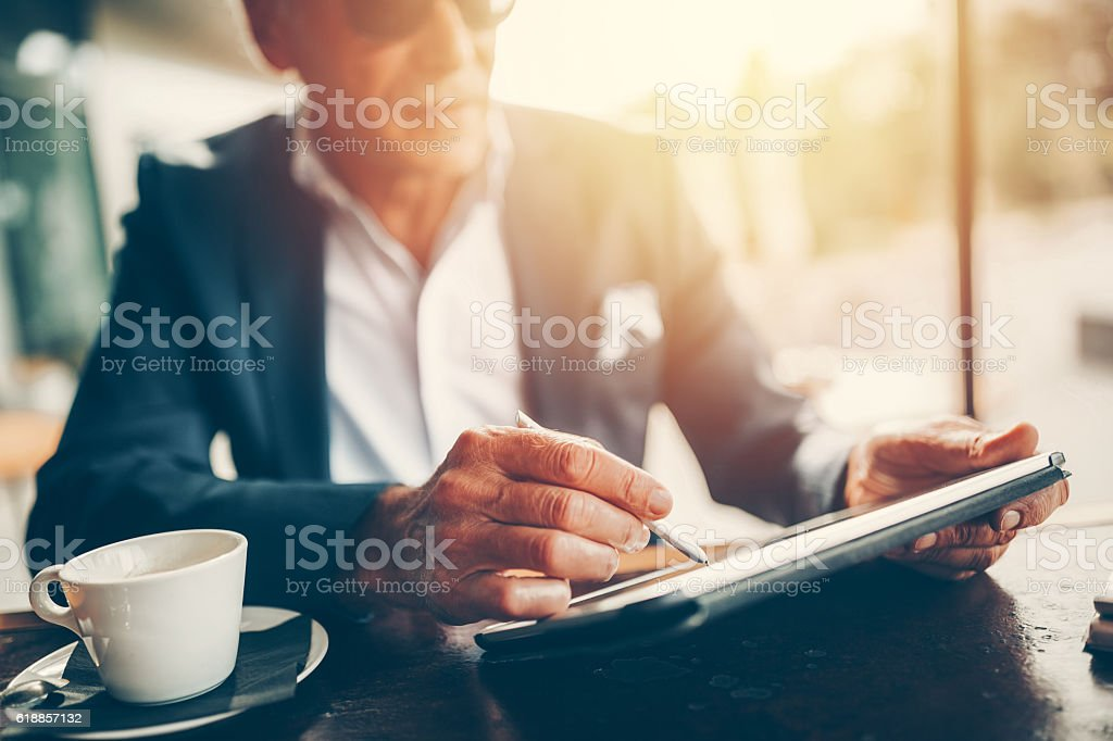 Businessman using tablet pc stock photo