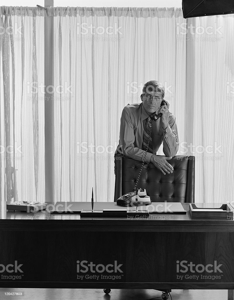 Businessman using telephone in office stock photo