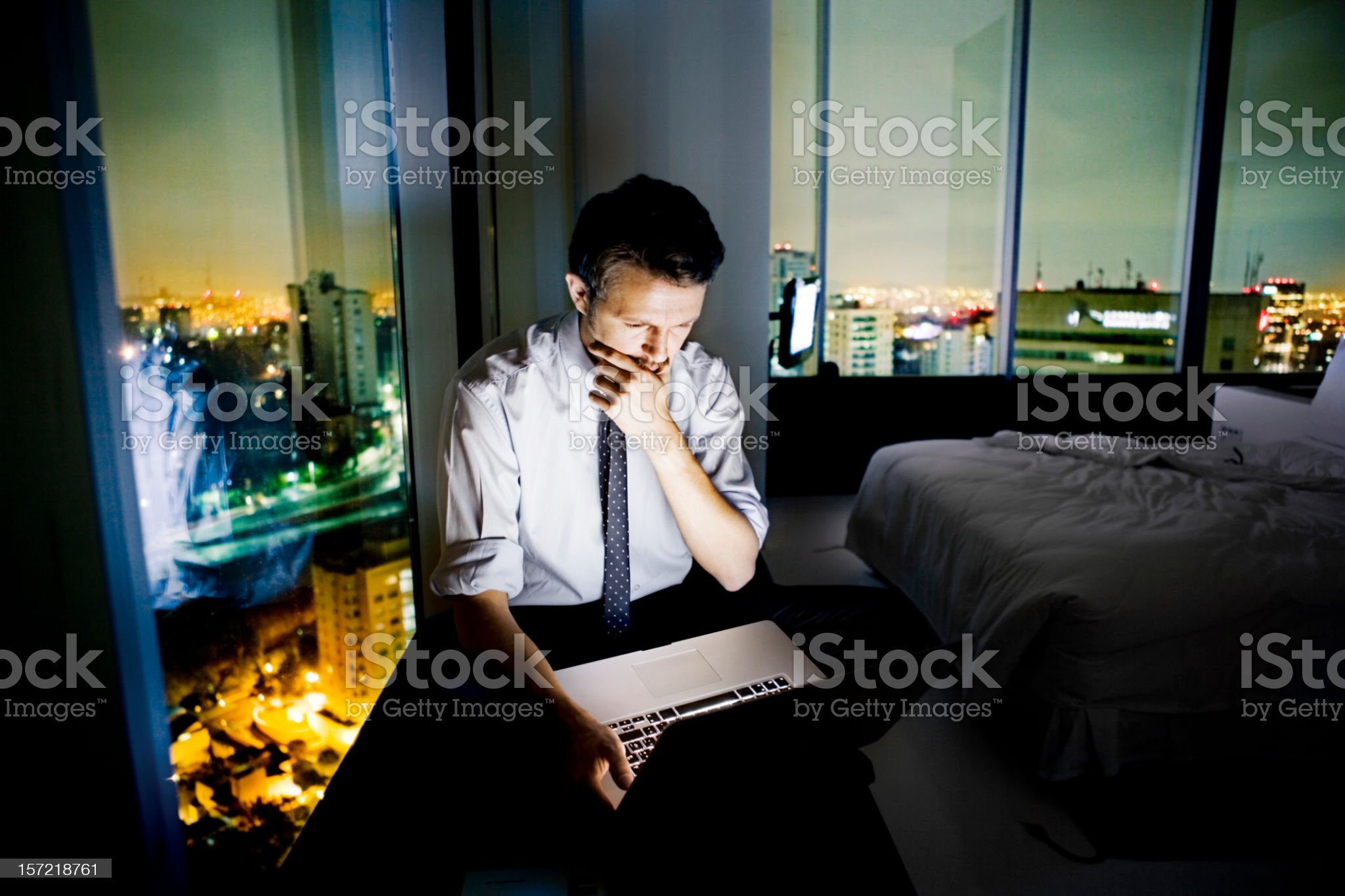 Businessman using the internet in hotel room royalty-free stock photo
