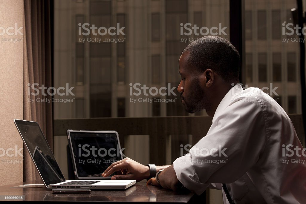 Businessman Using Three Mobile Devices royalty-free stock photo
