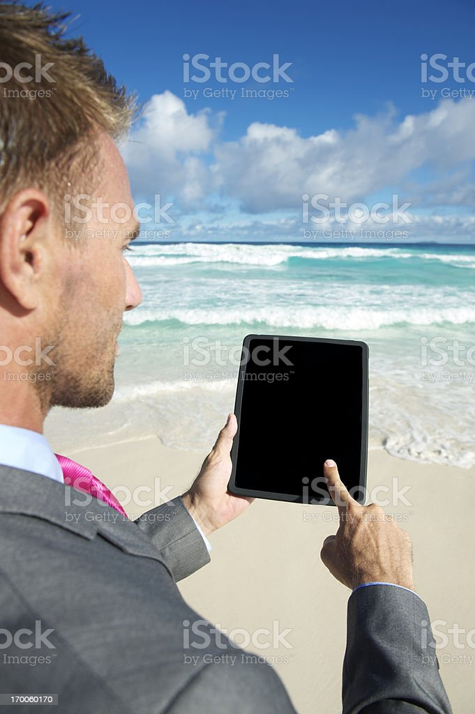 Businessman Using Touchscreen Digital Tablet Computer Tropical Beach royalty-free stock photo