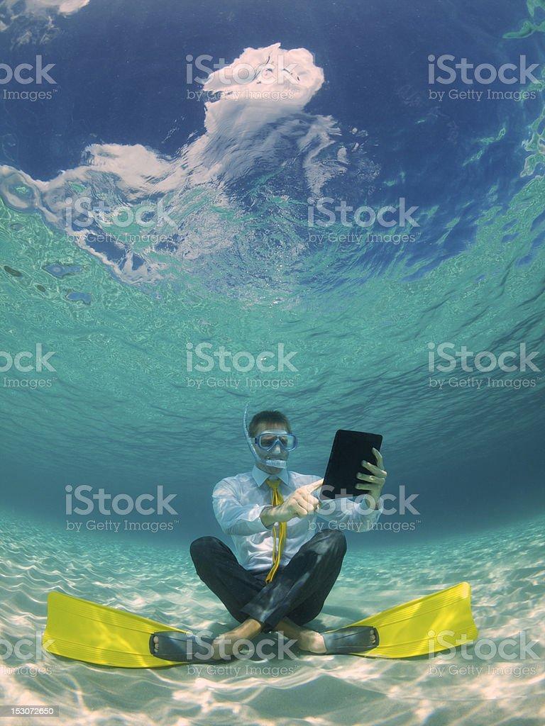 Businessman Using Waterproof Digital Tablet Underwater in Tropical Sea stock photo