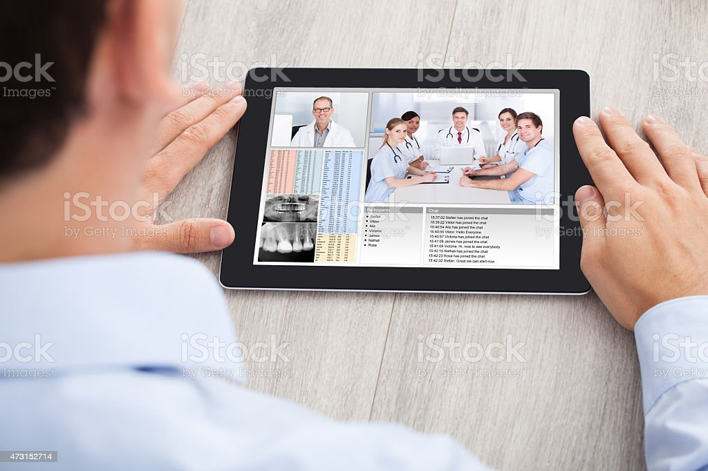 Businessman Video Conferencing With Medical Team stock photo