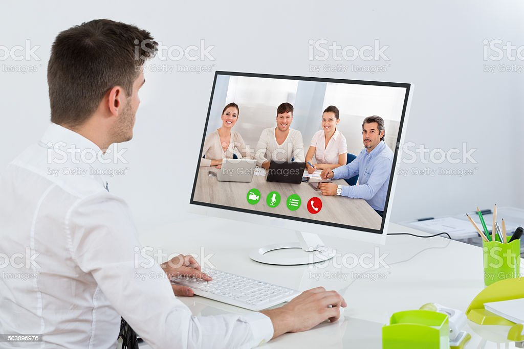 Businessman Videoconferencing With Colleagues stock photo