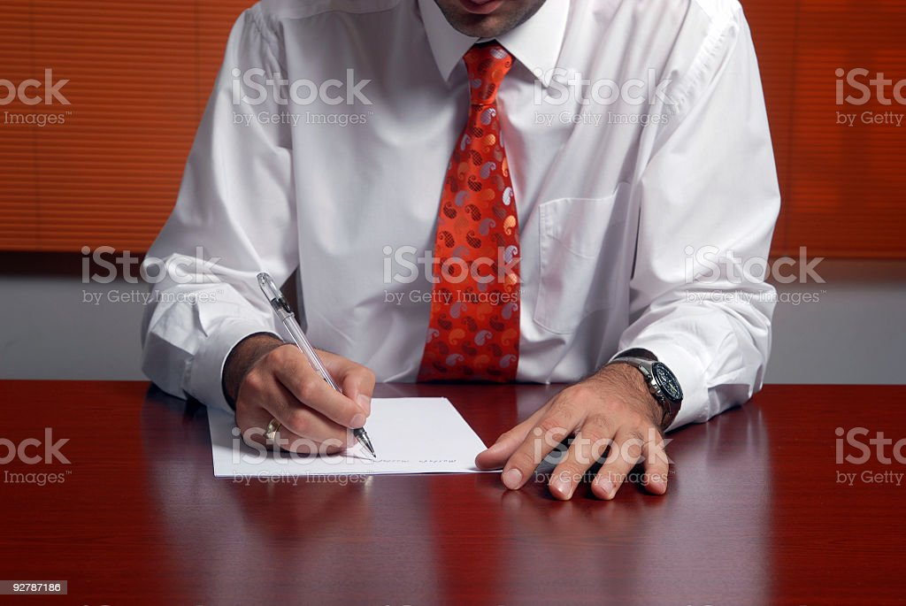 Businessman viewing the contract before signing royalty-free stock photo