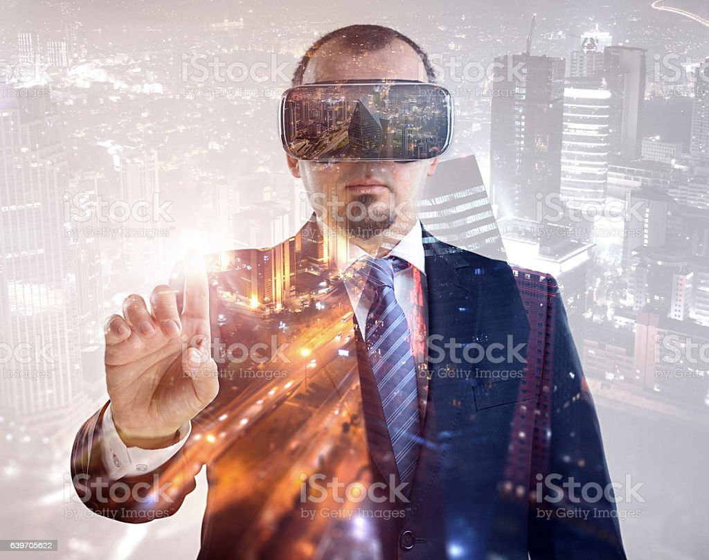 Businessman vr headset double exposure stock photo