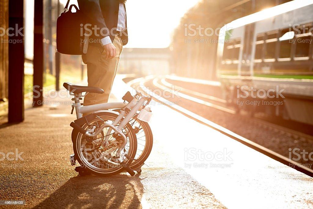 Businessman waiting at railway station platform stock photo