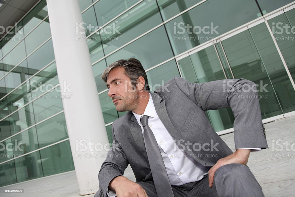 Businessman waiting client near building glass royalty-free stock photo
