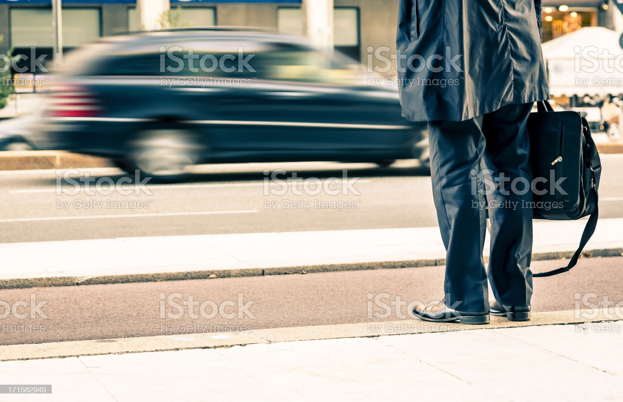 Businessman waiting for a Taxi royalty-free stock photo