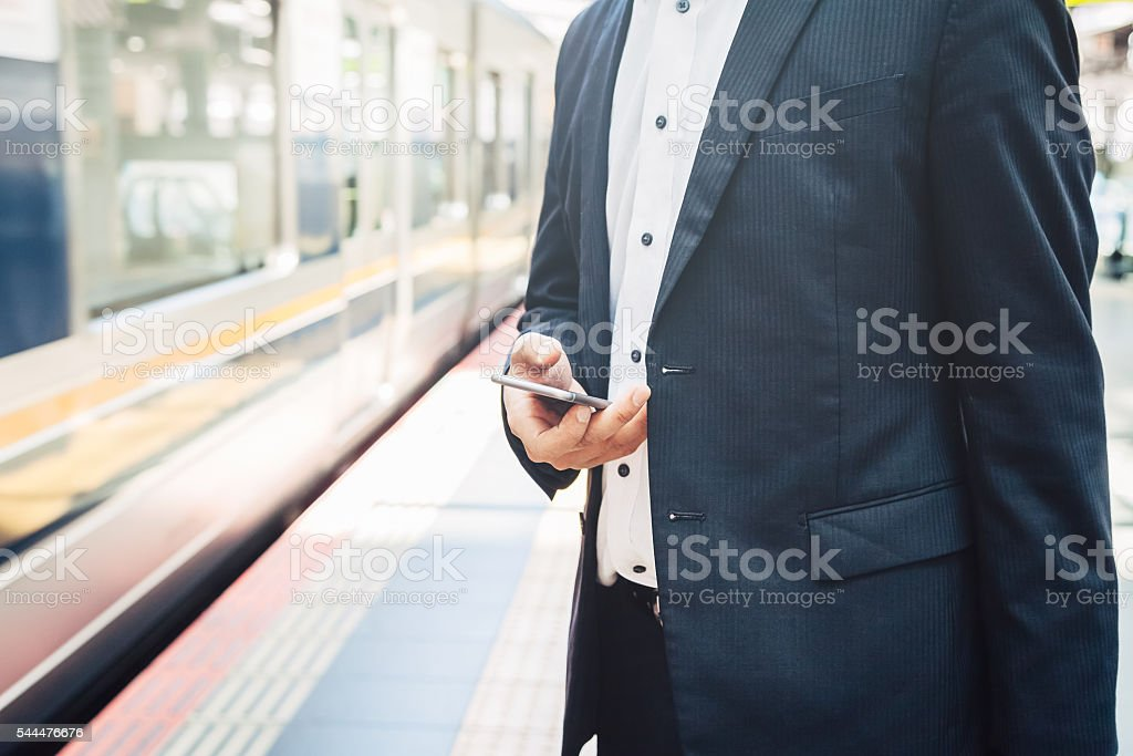 Businessman waiting for the train stock photo