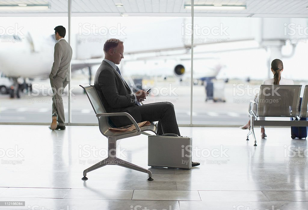 Businessman waiting in airport stock photo