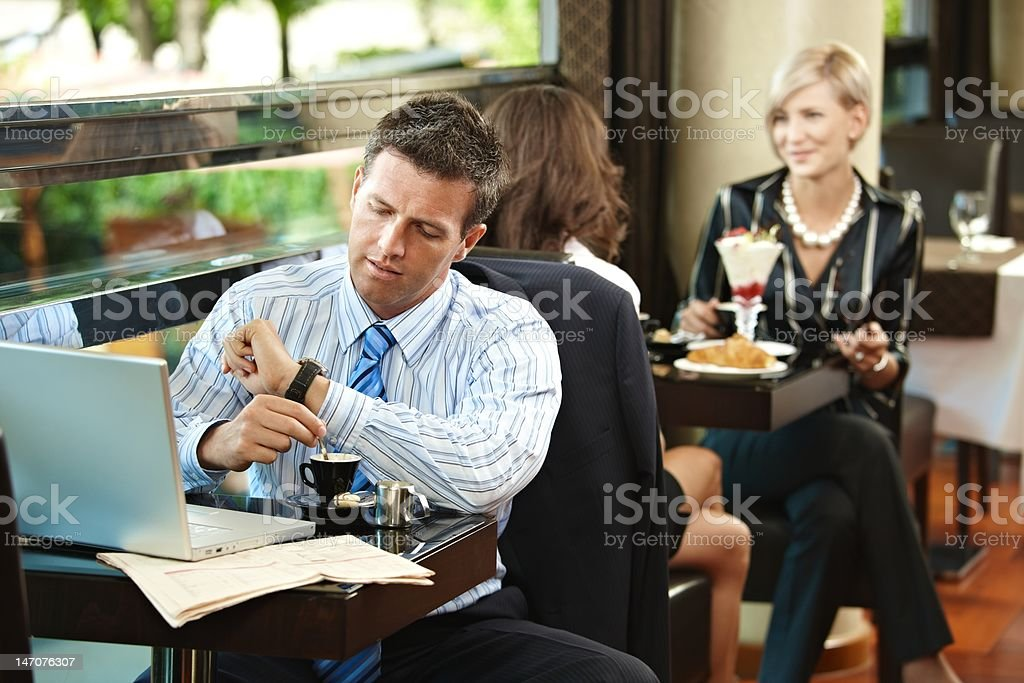 Businessman waiting in cafe royalty-free stock photo