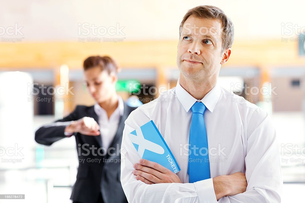 Businessman Waiting in Line at the Airport royalty-free stock photo