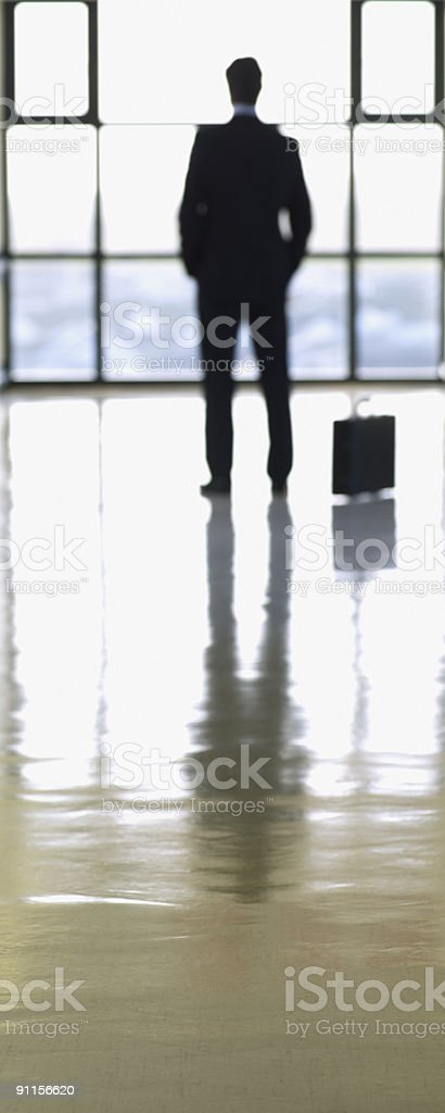Businessman waiting in lobby royalty-free stock photo