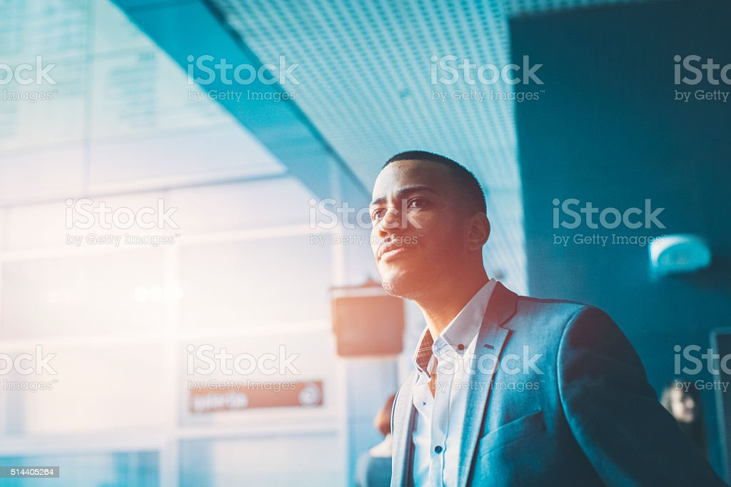 Businessman waiting in the office lobby stock photo