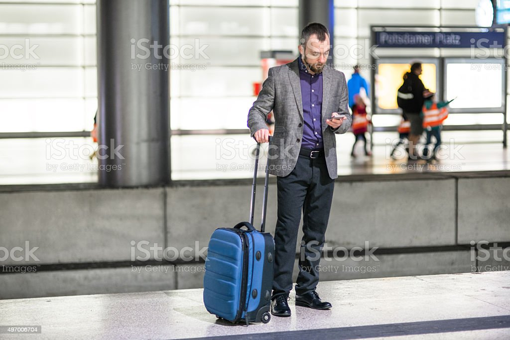 businessman waiting the train platform at the station stock photo