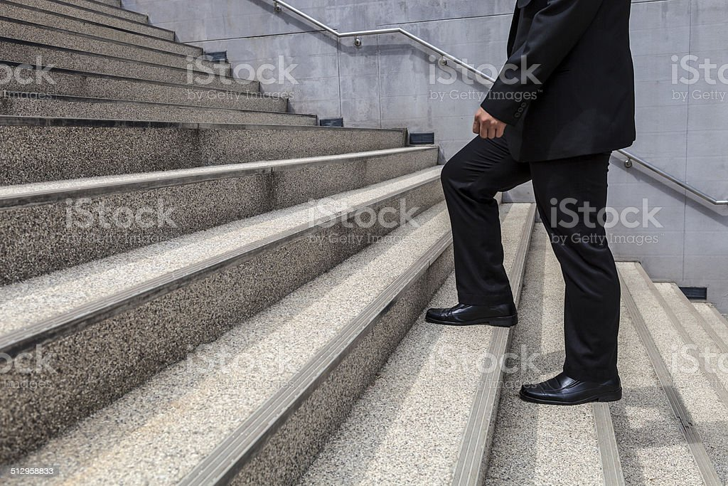 businessman walk up on stair background stock photo