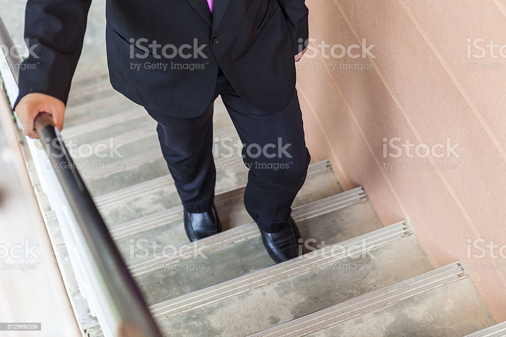 businessman walk up stair, promoted, achievement stock photo