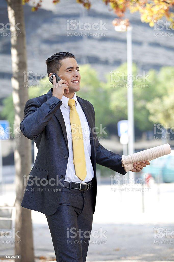 Businessman walking at the city park royalty-free stock photo