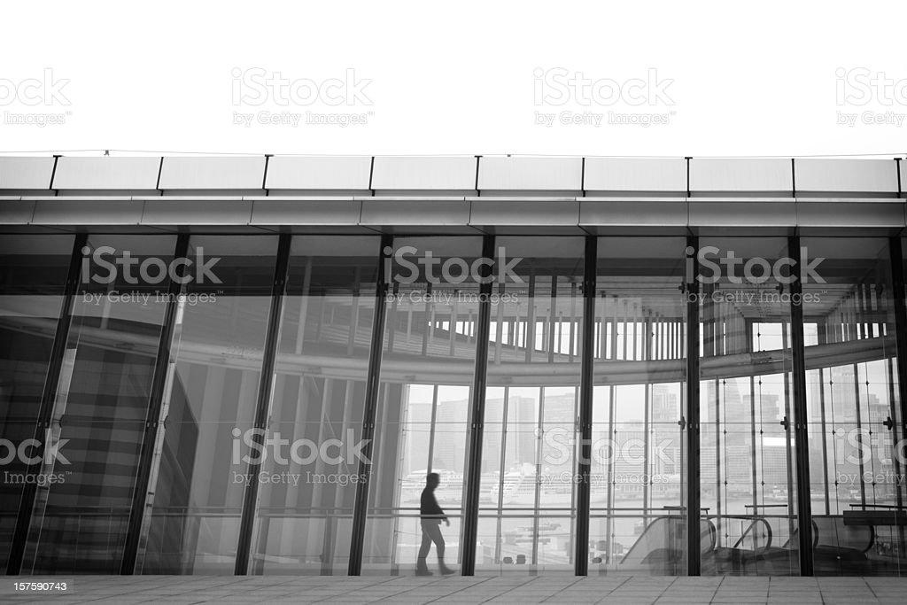 Businessman Walking by the Window stock photo