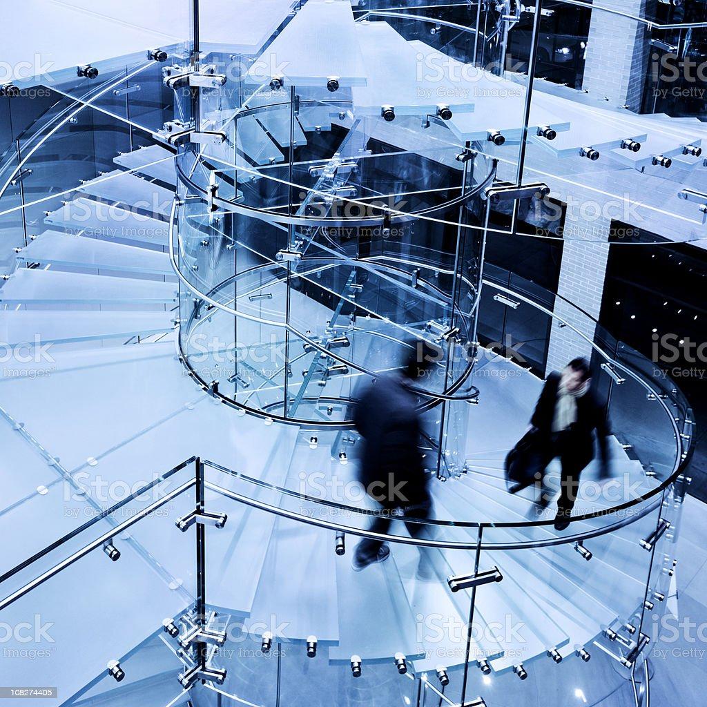 Businessman Walking Down Modern Glass Staircase royalty-free stock photo